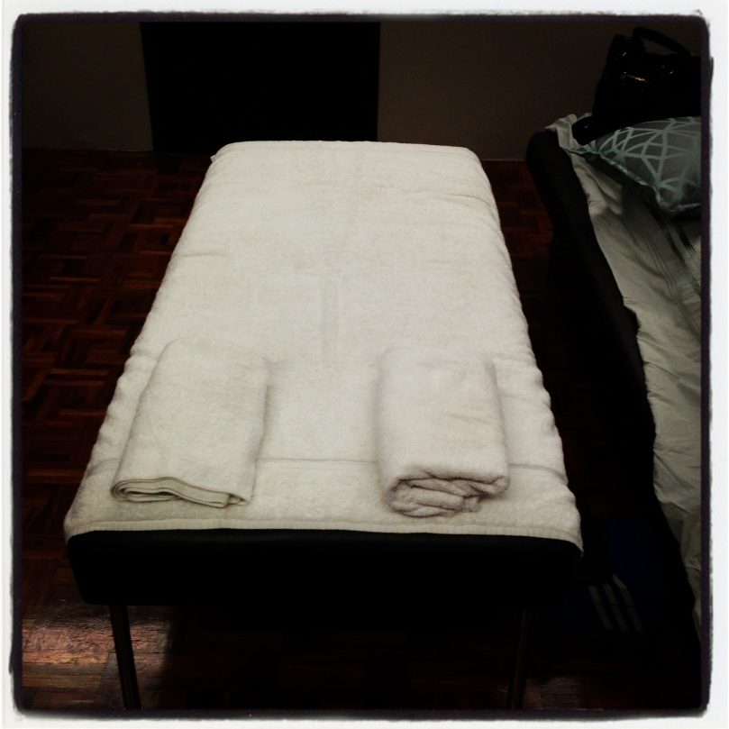 I transform our ottoman at the end of our bed into a massage table.