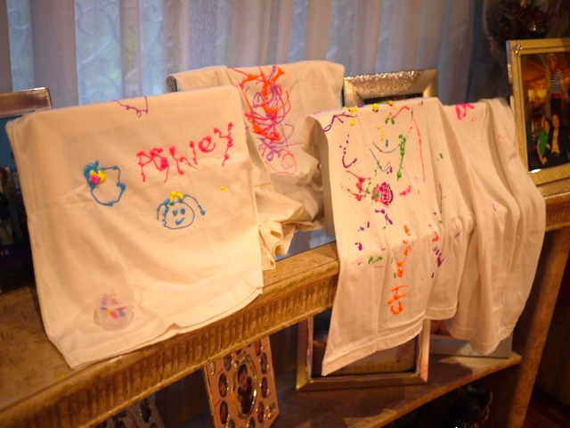 I prepared some puff fabric paint for them.  Once done, we hung them to dry by the time the party was over.