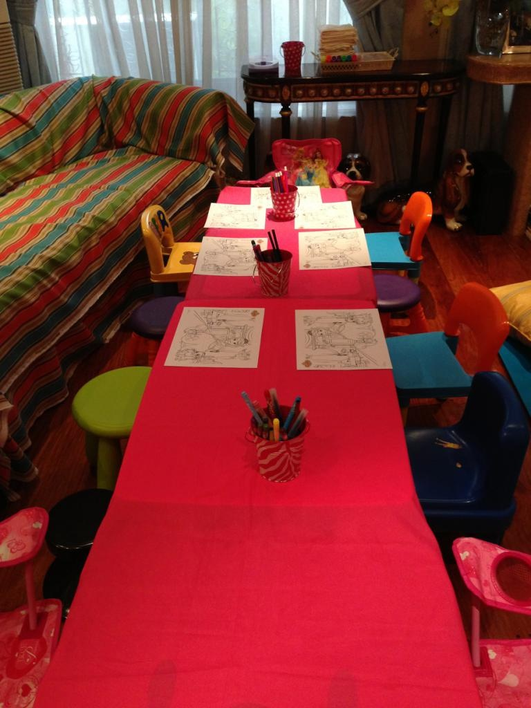The long table was for activities and eating.  1st activity was coloring Sofia the first pictures.  This was going on while waiting for all the guests to arrive.  Once they were done, they'd be hanging it with clips to display and for everyone to see.