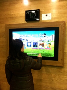 Here's how it works...Just follow instructions on this touch screen LCD.  Pose on the green background.  And the picture gets emailed to you.